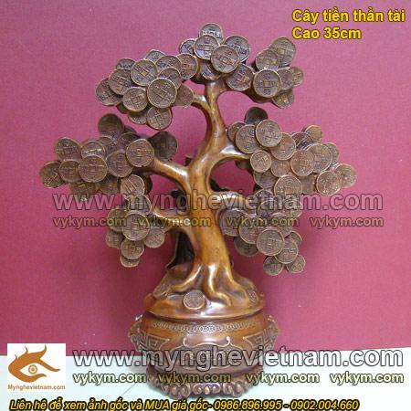 tượng thần tài thờ cúng đứng cây tiền
